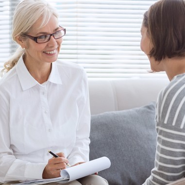 Woman helping female patient, counseling therapy session