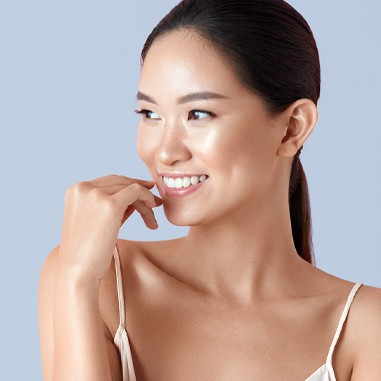 Woman with nice rejuvenated skin posing with hand