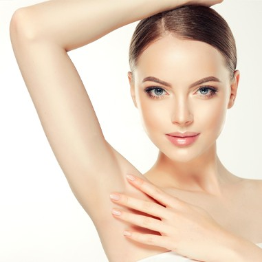 Woman with hand over underarm, hair removal