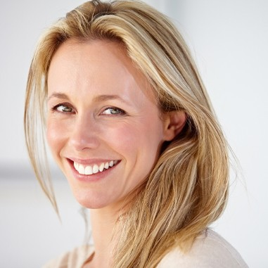 Mature woman with healthy skin and blonde hair