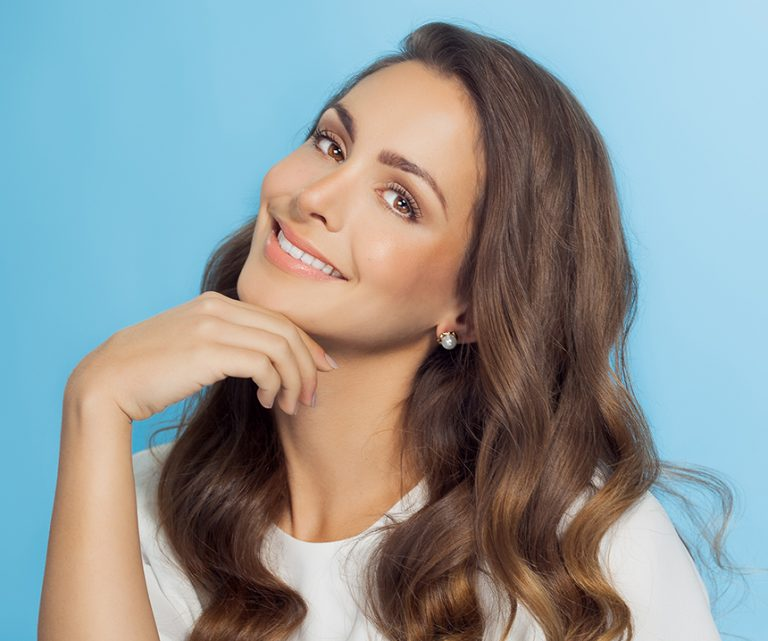 Smiling Woman Over Blue Background